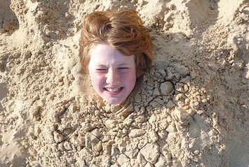 buried sand beach kid